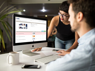 Man and woman in office using Aura Graphics online ordering system