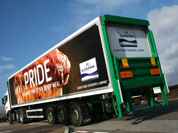 Advertising frame system for changeable promotional livery on Arla trucks