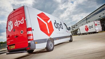 New livery design for DPD fleet applied to delivery vans and trailers at depot