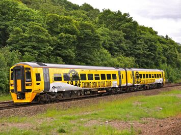 Tour de France promotional train wrap designed & installed for Northern