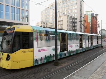 Festive wrap on Manchester Metrolink tram for Selfridges Christmas retail campaign