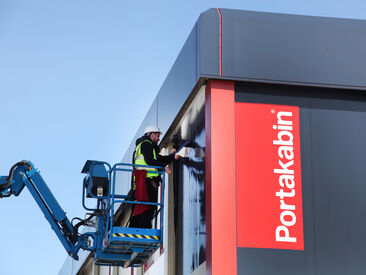 High-level installation of printed building wrap for Portakabin