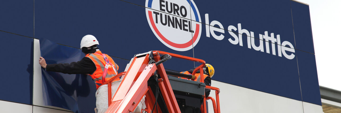 Installation of long-term branded building wrap to existing cladding for Eurotunnel