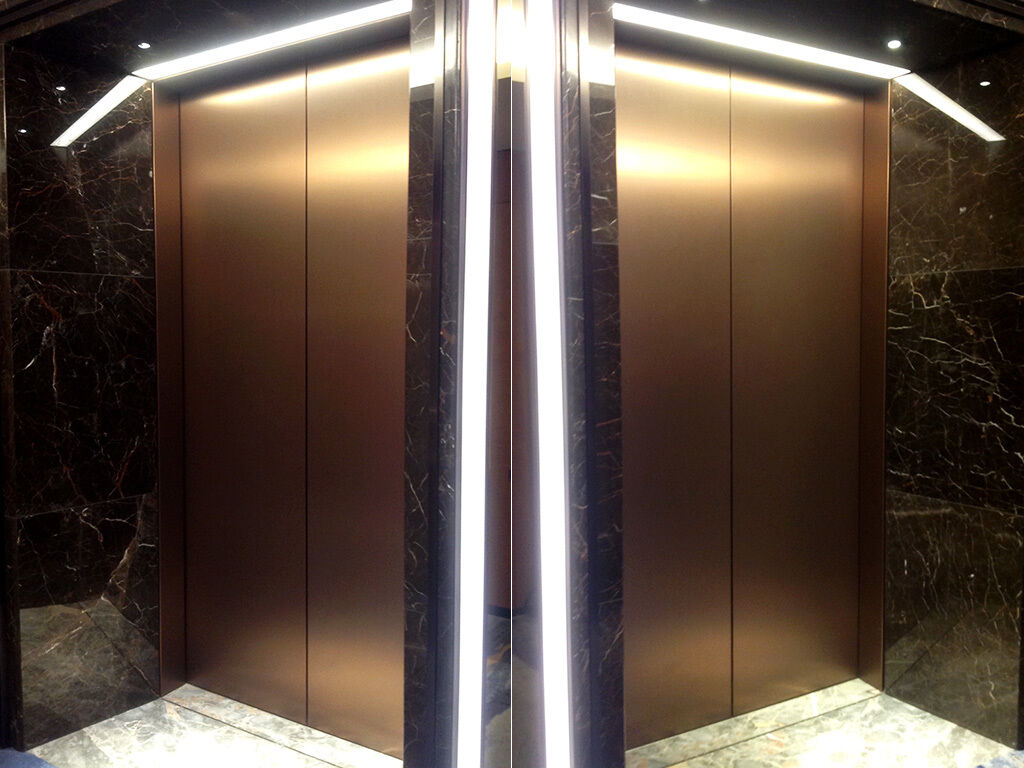 Bronze metallic effect 3M Di-Noc used to wrap lift doors