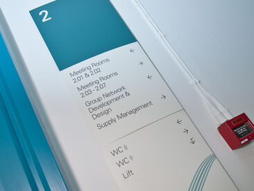 Custom branded floor directory & way finding sing system in office interiors