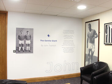 Printed wall graphics celebrating the club history in lounge area of Cardiff City FC