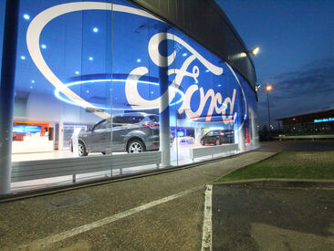 Specially printed gradient on optically clear window film to dress Ford car dealership glass frontage