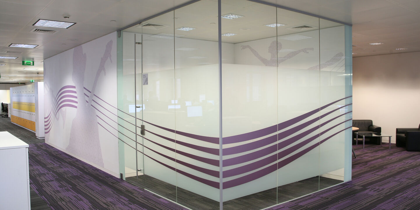 Interior graphics for walls and glass used for premium office workplace branding