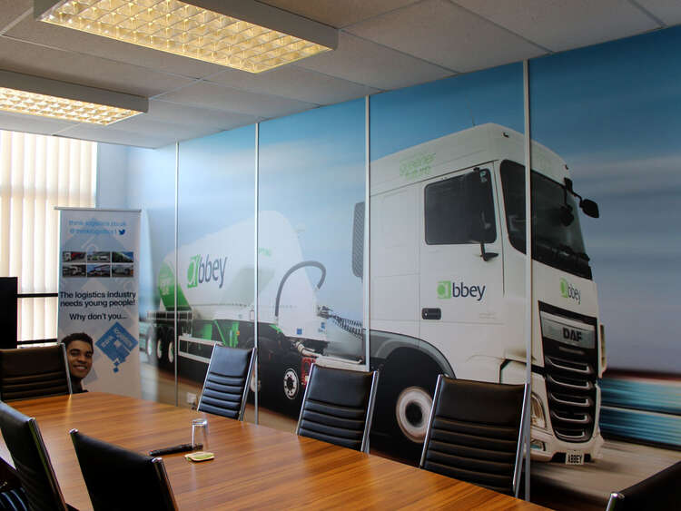 Printed wall wraps and banners brand Abbey Logistics meeting room