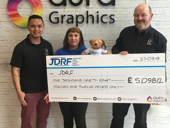 Aura Graphics Give Large Cheque to JDRF