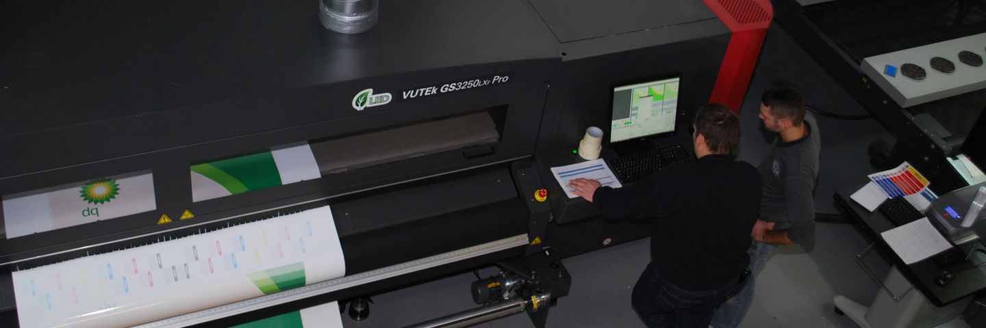 Efi Vutek wide-format digital printer using SuperFlex 3M inks for vehicle wraps, train wraps and interior graphics