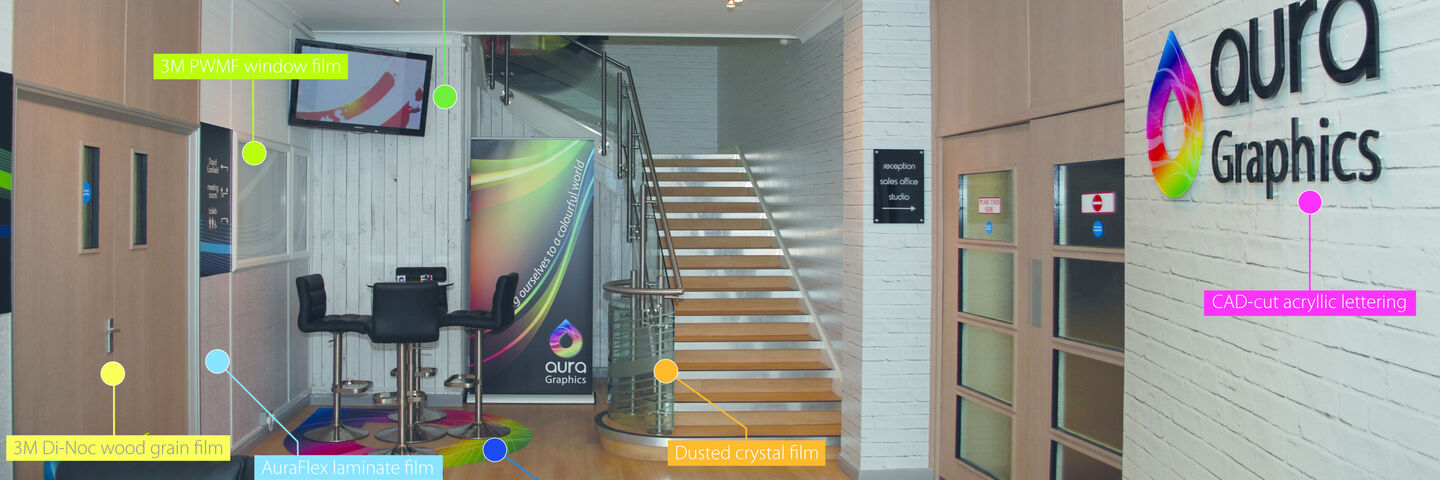Aura HQ reception area branded with a mix of architectural branding products