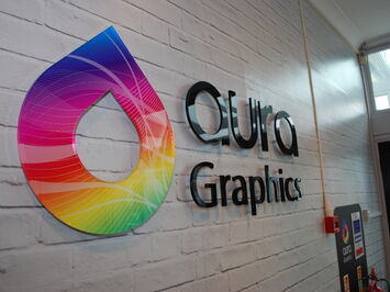 Aura Graphics 3D sign logo made from cut acrylic lettering & printed self-adhesive films