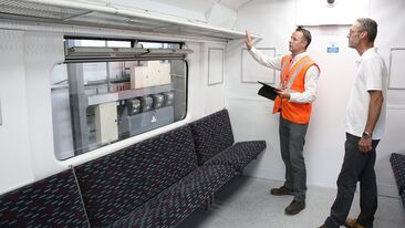 Project manager signing off train carriage interior refurbishment for Greater Anglia train operator