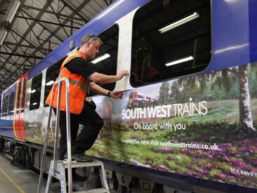 Installing promotional train wrap on South West Trains carriage