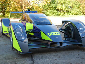 Reflective conspicuity livery in Police Battenburg on Caparo T1 sports car