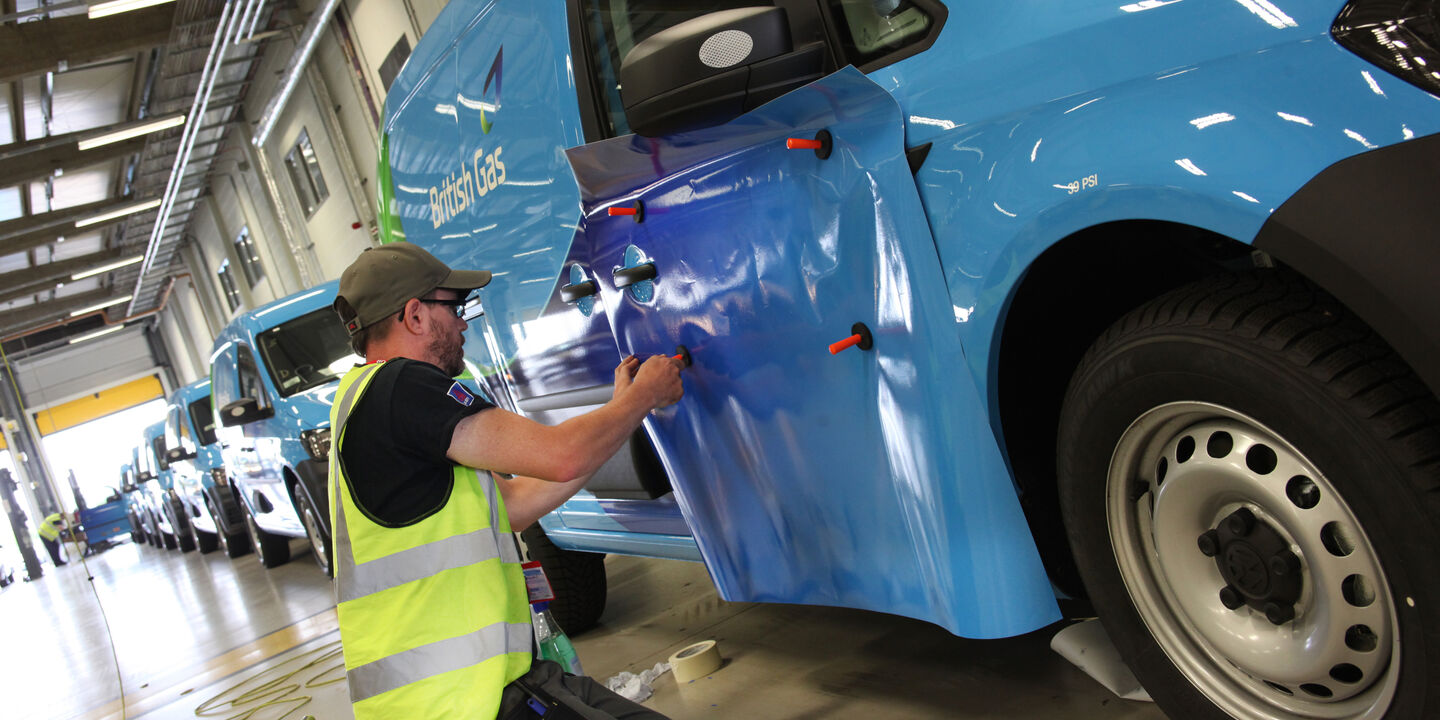 Aura technican installing commercial van graphics for British Gas fleet livery