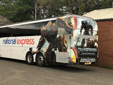 Mega rear wrap around advertising campaign for Transformers movie on National Express coach