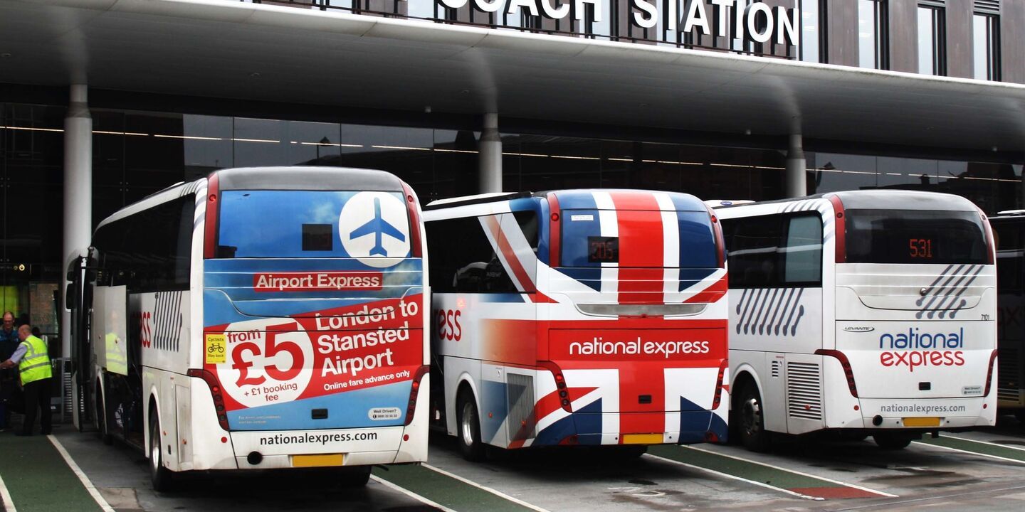 Advertising and corporate rear bus wraps on National Express coaches