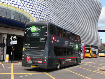 West Midlands bus on the road in fresh livery