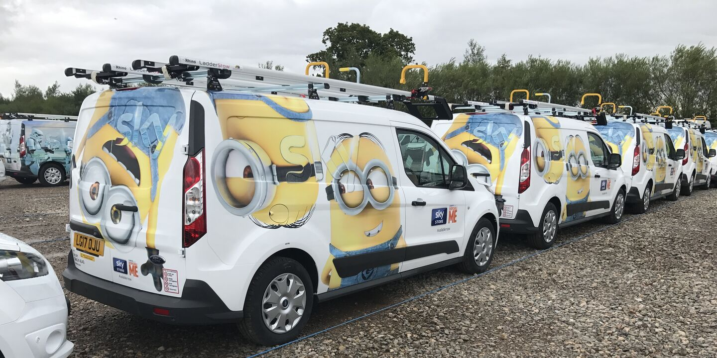Sky van fleet wrapped in Minions Movie livery