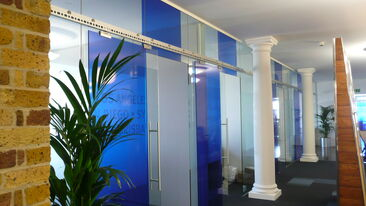 Translucent coloured window film used on office interior glazing