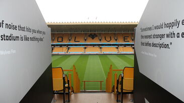 Printed wall graphics leading to pitch side at Wolves football stadium